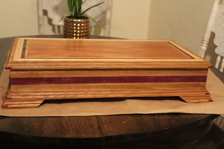 Jewelry box made from white oak and purple heart hardwoods.